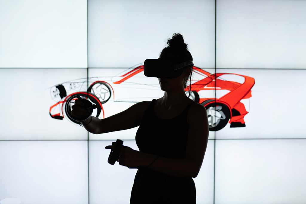 Woman wearing VR Headset with illustrated Red Car displayed behind her