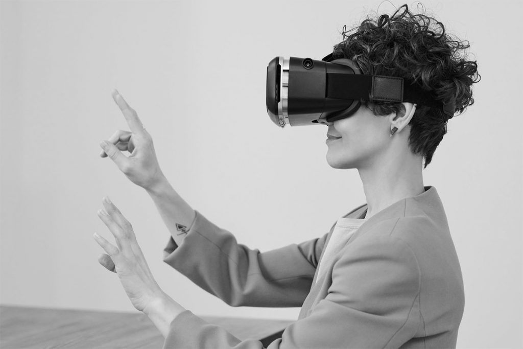 Black and White image of woman with virtual reality headset