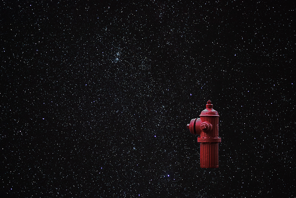 Night sky with fire hydrant